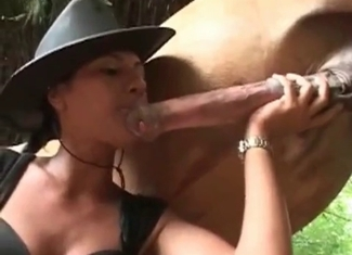 Sexy model is giving a blowjob to a beast